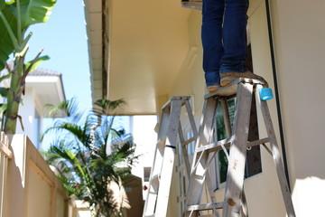 repairman worker standing on ladder