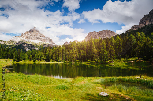 Wall mural Stunning image of the Antorno lake in National Park Tre Cime di Lavaredo.