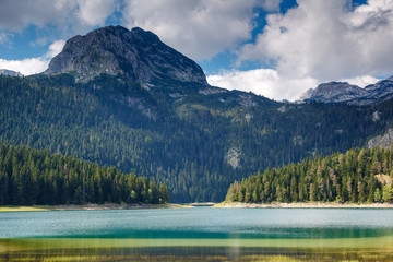 Fototapete - Black lake in Durmitor national park.