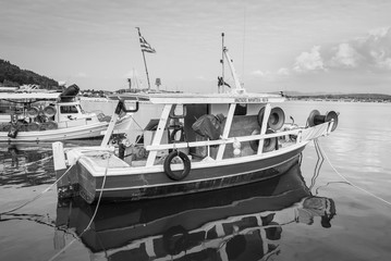 Katakolon, Greece - October 31, 2017: Fishing boats moored in the port of the Katakolon (Olimpia), Greece. Black and white photography.