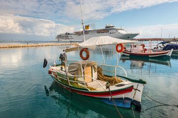 Katakolon, Greece - October 31, 2017: Fishing boats and Costa neoClassica Cruise Ship moored in the port of the Katakolon (Olimpia), Greece.