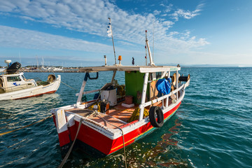 Katakolon, Greece - October 31, 2017: Colorful wooden fishing boats in harbor of the Katakolon (Olimpia), Greece.
