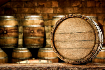 Wall Mural - Retro old barrel on wooden table and free space for your decoration.