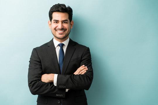 Handsome Hispanic Businessman In Black Suit