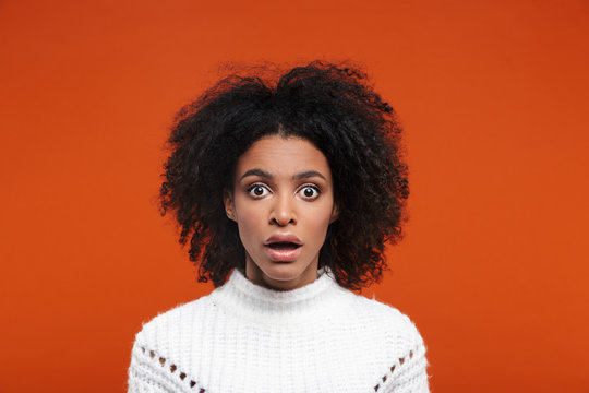 Shocked young attractive african woman looking at camera