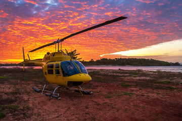 Foto op Plexiglas Helicopter Helicopter on the land next to the sea at sunset, Australia, Northern Territory, Seisia Cape York
