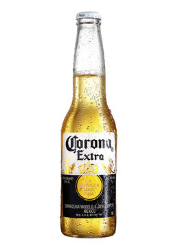 POLTAVA, UKRAINE - February 10, 2018: Photo of Corona Extra Beer bottle isolated on white.Corona Extra is produced in Mexico and exported to all other countries all over the world.