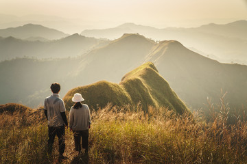 Couple looking the scenics of mountain