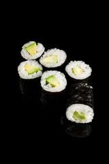 Fototapeta delicious sushi maki with avocado isolated on black obraz