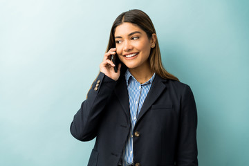Smiling Pretty Businesswoman On Call