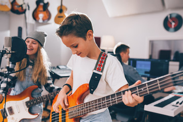 kids rock band playing in studio