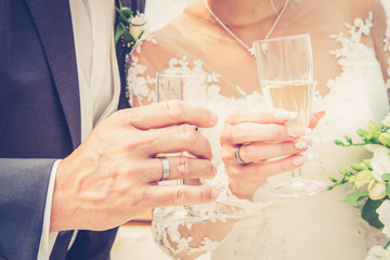 wedding theme picture with a close up bride and groom holding a glass of champagne
