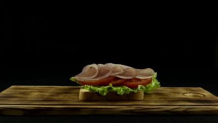 Fototapete - make sandwich, toast, bread, sausage, ham, lettuce, sauce, tomato. Time lapse. Close up