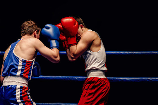 boxers opponent stand in defense in boxing match