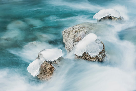 Ice formations in the Cordevole River, Cadore, dolomites, Italy, Europe