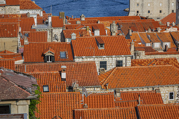 Orange-tiled roofs of the magnificent Old Town of Dubrovnik from the City Walls. Dubrovnik, Mediterranean, Croatia.