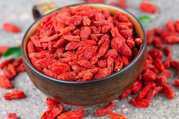 Cup with dried goji berry in close-up. Selective focus, above view