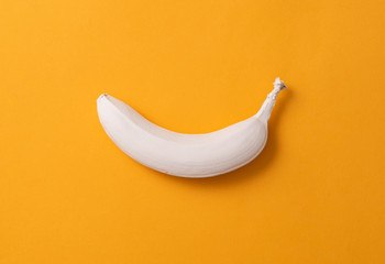 Abstract image of a white banana on a yellow background. minimalism concept