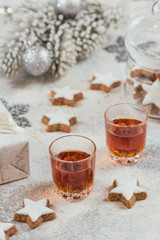 Two glasses of whiskey or bourbon, star cookies and decoration on white background