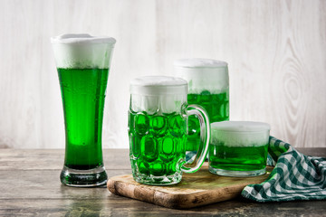 Traditional St Patrick's Day green beers on wooden table