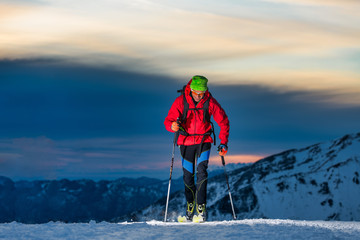 Ski touring at night in the last hours of the day Wall mural