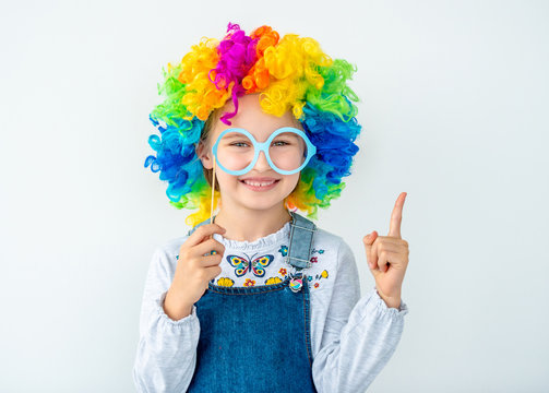 Smiling girl in multicolor wig