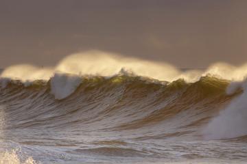 Spraying wave sunset