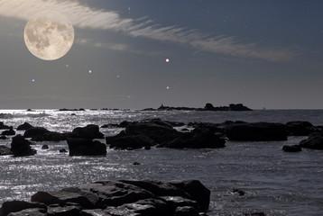 Rocky coast in a full moon night
