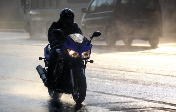 Young man riding on a motorcycle.
