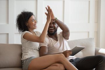 African wife gives high five husband celebrating received fantastic opportunity Fotobehang