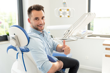 Man showing thumbs up at the dental clinic
