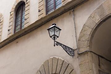 Old metal beautiful street lantern lamp on the wall Fotomurales