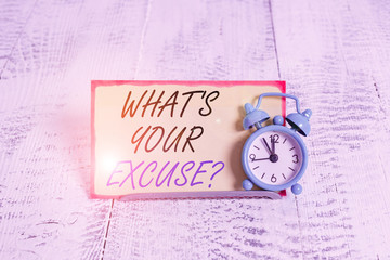 Writing note showing What s is Your Excuse question. Business concept for Explanations for not doing something Inquiry Alarm clock tilted above buffer wire in front of notepaper