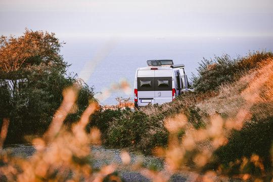 camper van with blurred foreground