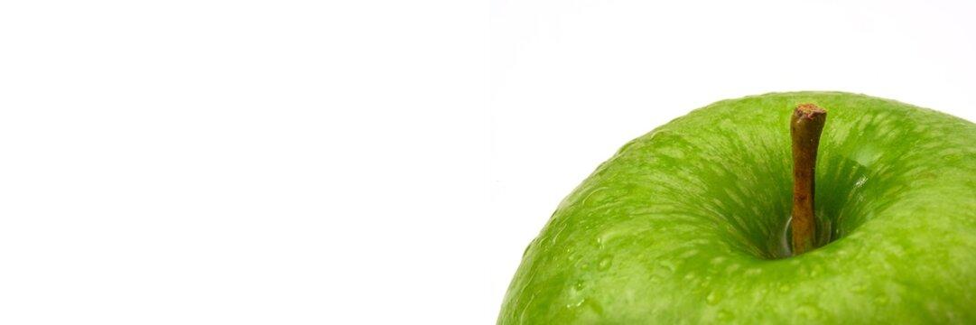 Detail eines grünen Apfels als Panorama