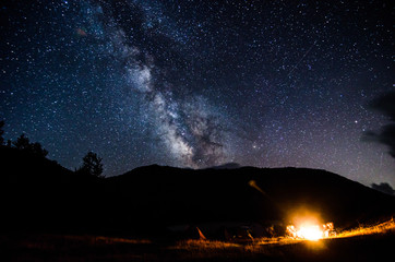 Campers with fireplace under night sky in albanian nature near Fushe Stude, Albania
