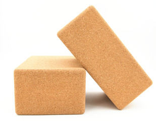 two cork yoga blocks isolated on a white background
