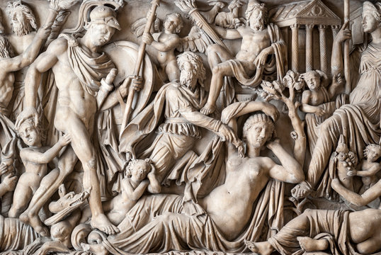 Italian Renaissance sculptural relief of metaphorical men and women draped in robes in Rome, Italy