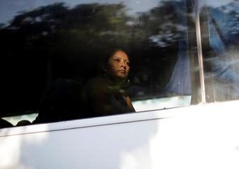 A migrant is seen in a bus near Frontera Hidalgo