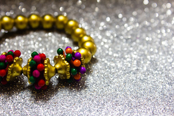 Gold colour hair bands with multi-colour beads. Designer hair bands for girls.