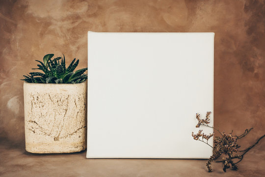 White wrapped canvas on stretcher and decorative art background. Mockup picture.