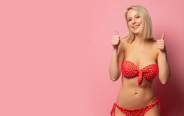 Beautiful blonde woman in red bikini