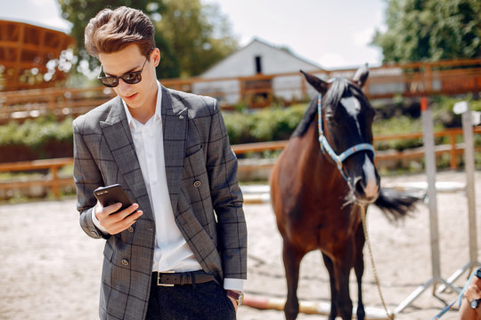 Horse theme. Businessman with a horse. Man in a suit