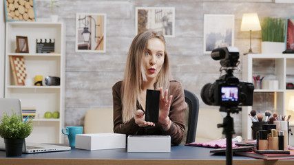 Famous beauty influencer recording unboxing video for her vlog