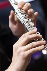 Fototapete -  Hands of a musician playing flute closeup
