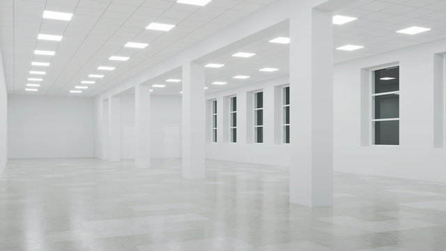 Interior of an empty commercial building with white walls. Office space. Night. Evening lighting. 3D rendering.