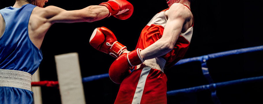boxing match in ring boxer lands right jab to opponent
