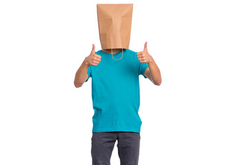 Fototapete - Portrait of teen boy with paper bag over head making thumb up gesture, isolated on white background. Child showing success sign.