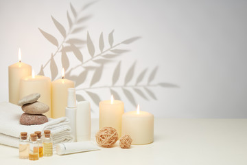 Obraz Spa still life with creams, essential oils, candles on light background. Healthy lifestyle, body care, Spa treatment - fototapety do salonu
