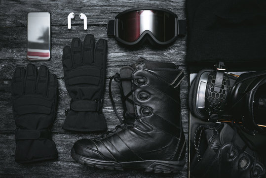 Snowboard equipment flat lay concept background.